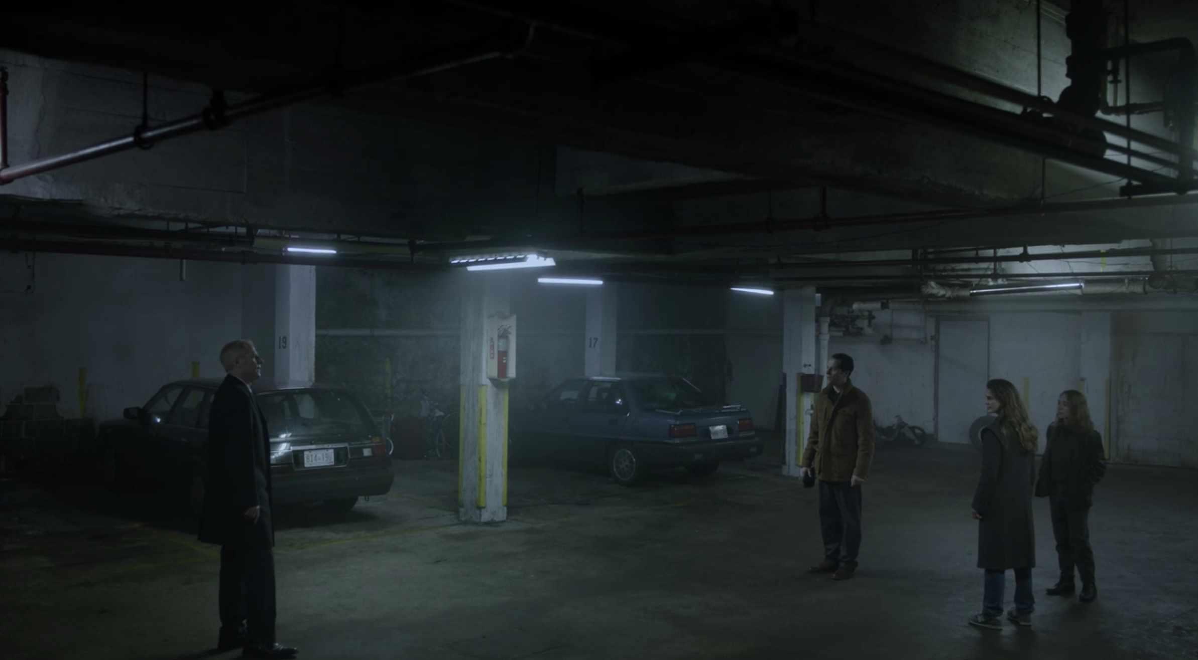 Stan (Noah Emmerich) confronts the Jenningses in the parking garage.